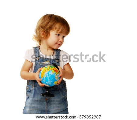 beautiful little girl in the age of two years holding a globe  - stock photo
