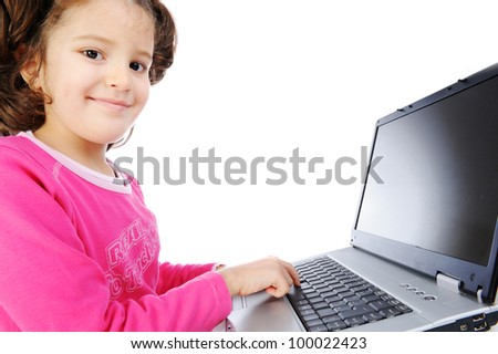 Beautiful little girl isolated with laptop - stock photo