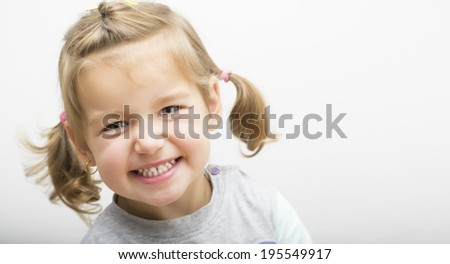 Beautiful little girl laughing - stock photo