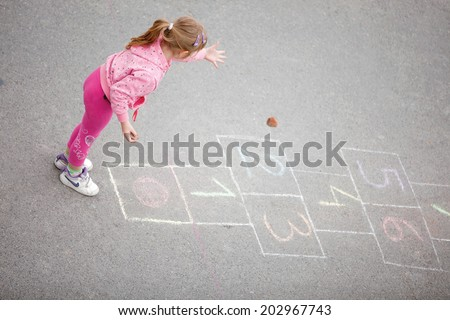 beautiful little girl on the hopscotch - stock photo