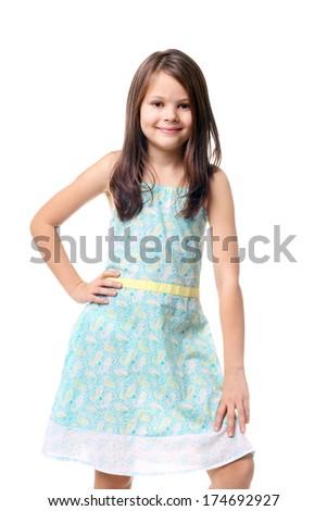 beautiful little girl posing in the summer dress - stock photo