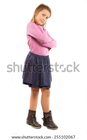 Beautiful little girl posing with crossed arms - stock photo