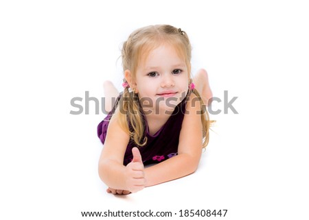 Beautiful little girl shows finger as sign that everything is fine - stock photo