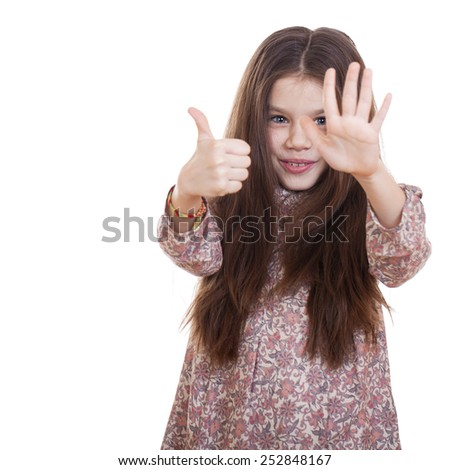 Beautiful little girl shows her fingers and palm, isolated on white background - stock photo