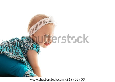 Beautiful little girl smiling while playing - stock photo