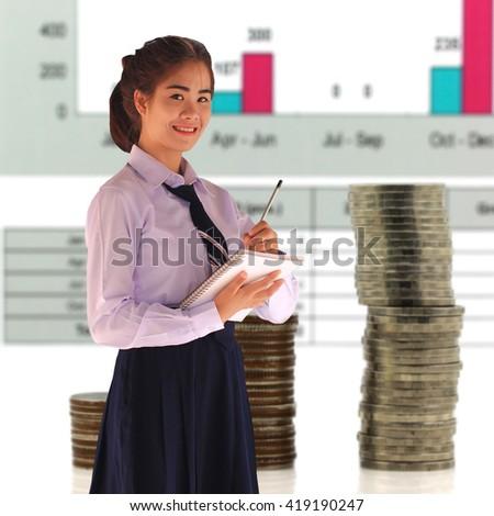 Beautiful little girl standing near blackboard in classroom - stock photo