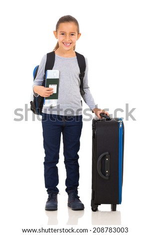 beautiful little girl traveling holding passport and ticket  - stock photo