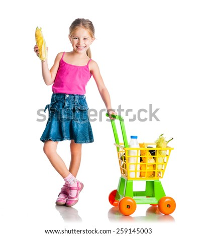 beautiful little girl with a basket from the supermarket holding corn - stock photo