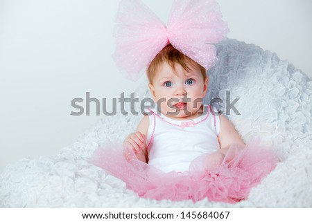 beautiful little girl with a big pink bow on her head - stock photo