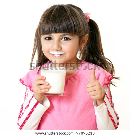 Beautiful little girl with a glass of milk - stock photo
