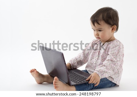Beautiful little girl with a notebook - stock photo