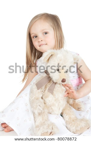 Beautiful little girl with bear toy over white - stock photo