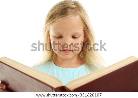 Beautiful little girl with book, isolated on white - stock photo