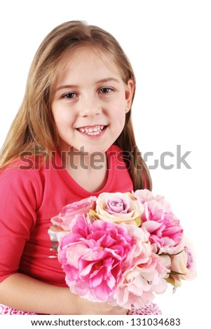 Beautiful little girl with bouquet for Mom or Father - stock photo