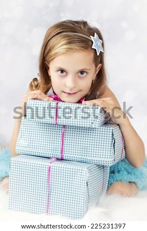 Beautiful little girl with christmas presents - stock photo