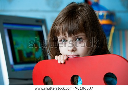 beautiful little girl with computer - stock photo