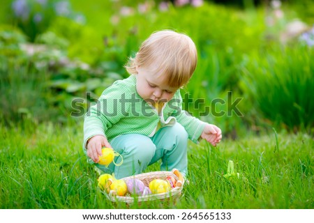 beautiful little girl with easter eggs in nature - stock photo