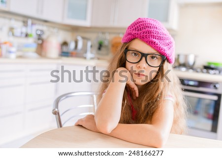 Beautiful little girl with glasses and red beret closeup. - stock photo