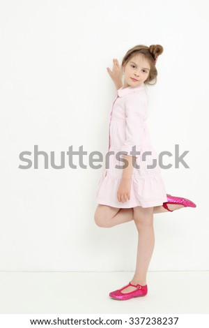 Beautiful little girl with gorgeous hair - stock photo