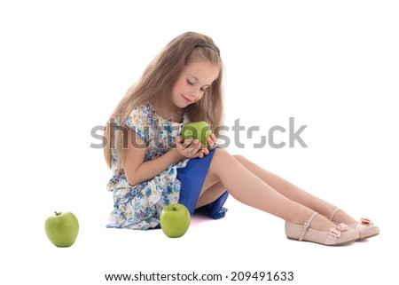 beautiful little girl with green apples isolated on white background - stock photo