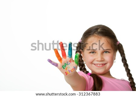 Beautiful little girl with hands in the paint  - stock photo