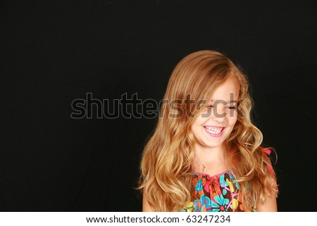 beautiful little girl with long blonde hair smiling - stock photo