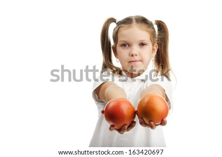 beautiful little girl with oranges in her hands - stock photo