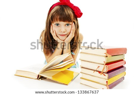 Beautiful little girl with school books on the table. Isolated on a white background - stock photo