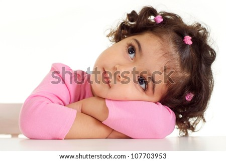 Beautiful little girl with tails in a pink blouse - stock photo