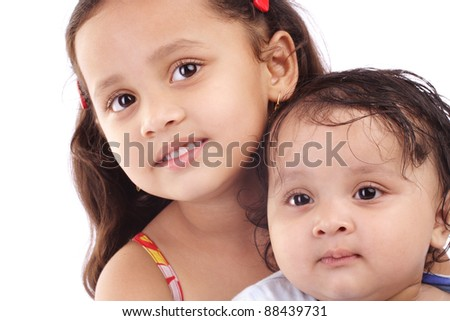Beautiful little Indian sisters - stock photo