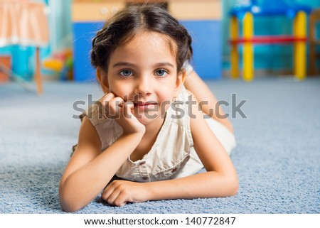 Beautiful little latin girl portrait in daycare - stock photo