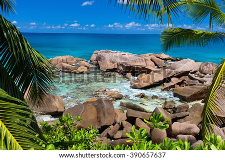 Beautiful little secluded beach at tropical La Digue island in Seychelles - stock photo