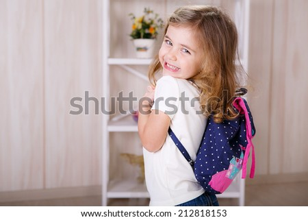 Beautiful little with a backpack - stock photo