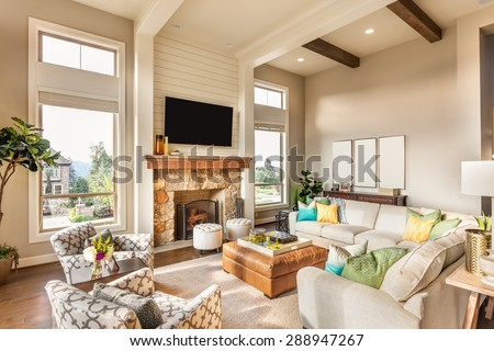Beautiful living room in brand new luxury home with hardwood floors and amazing view - stock photo