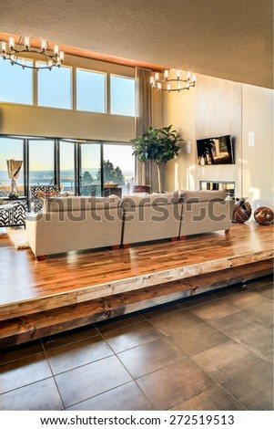 Beautiful living room with hardwood floors and amazing view - stock photo