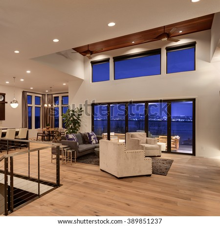 Beautiful living room with hardwood floors and amazing view at night - stock photo