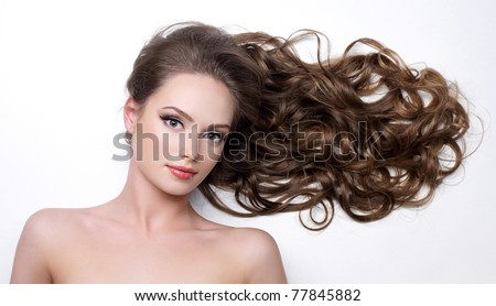 Beautiful long curly hair of young woman - white background - stock photo