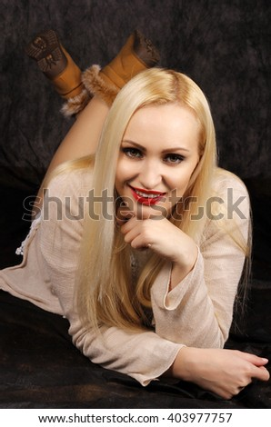 Beautiful long hair blond posing in the studio. - stock photo