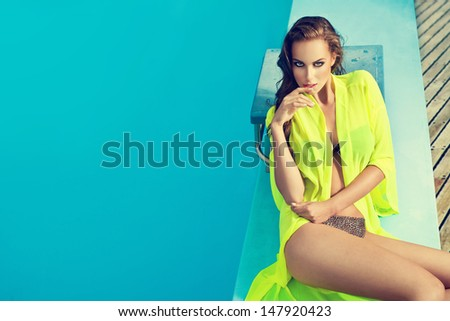 beautiful long hair female model posing by the pool, outdoor portrait  - stock photo