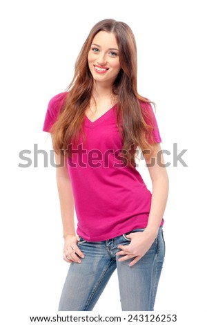 Beautiful long hair girl wearing purple t-shirt and jeans stands with hands on the pockets, isolated on white - stock photo