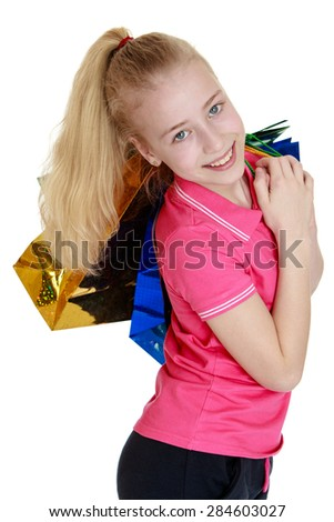 Beautiful long-haired girl the blonde is holding back lots of colorful shopping bags.- isolated on white background - stock photo