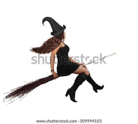 Beautiful long-haired witch flying on a broomstick - stock photo