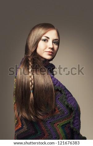 beautiful long haired young woman looking at camera - stock photo