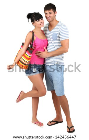 Beautiful loving couple at summer vacation isolated on white - stock photo