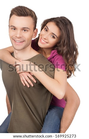 Beautiful loving couple. Cheerful young loving couple hugging and smiling at camera while standing isolated on white - stock photo