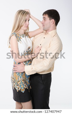 Beautiful loving couple hugging and having fun. Happy Couple in Love isolated on white - stock photo