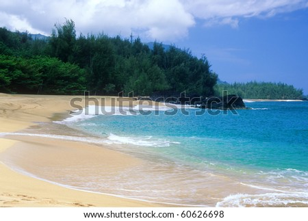 Beautiful Lumahai Beach is a secluded paradise found on the north shore of Kauai, Hawaii. - stock photo