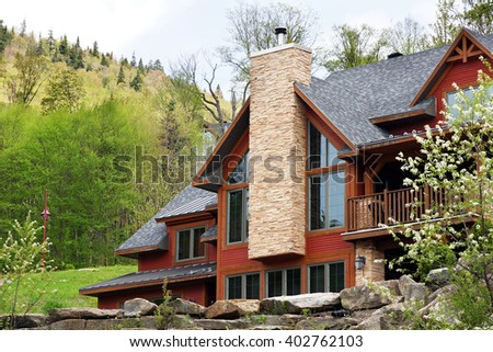 Beautiful luxurious house or cottage in the hills spring time - stock photo