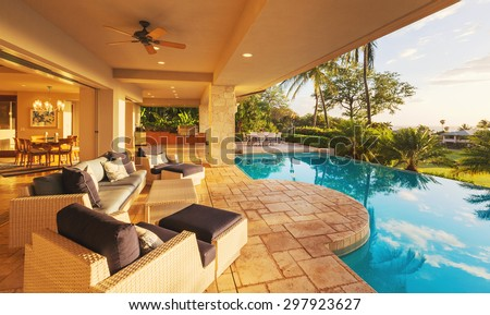 Beautiful Luxury Home with Swimming Pool at Sunset  - stock photo