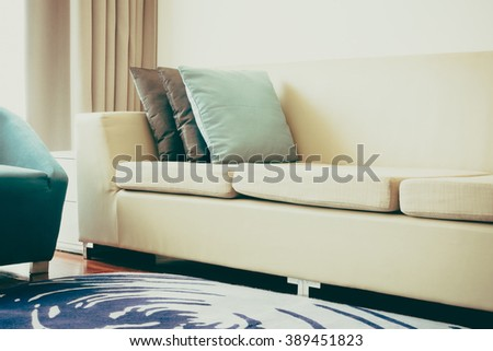 Beautiful luxury pillow on sofa decoration in living room interior - Vintage Light Filter - stock photo